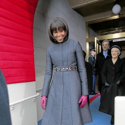 First lady Michelle Obama wears a Thom Browne navy coat and dress ensemble to the president's inauguration Monday.