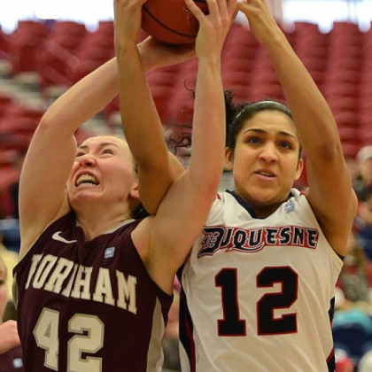 Duquesne's Jocelyn Floyd, right, fights with Fordham's Abigail Corning for a rebound.