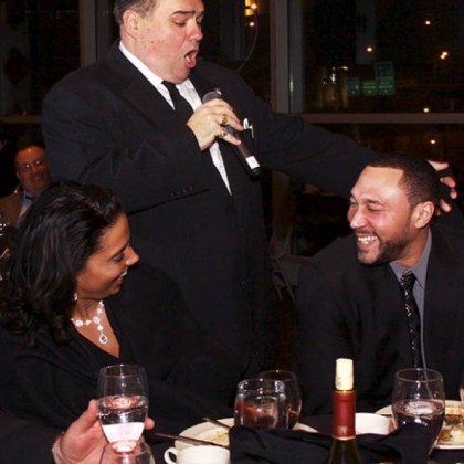 Latasha Batch looks on as Dominic Mantuso of The Three Waiters serenades Charlie Batch.