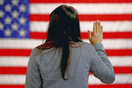 A woman takes the oath of allegiance Monday during a naturalization ceremony in Newark, N.J.