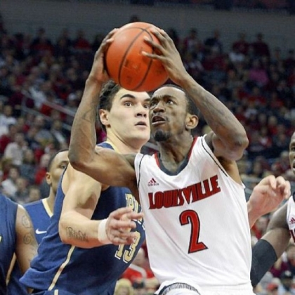 Louisville's Russ Smith drives around the defense of Pitt's Steven Adams during the second half in Louisville, Ky.