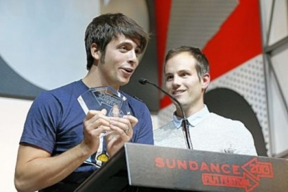 "Documentary subject Rocky Braat, left, and director Steve Hoover accept the Grand Jury Prize: U.S. Documentary for ""Blood Brother"" during the 2013 Sundance Film Festival Awards Ceremony on Saturday."