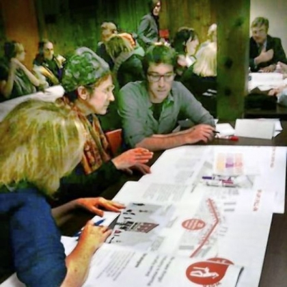 Participants at a recent Upper Lawrenceville meeting confer on neighborhood improvement strategy.