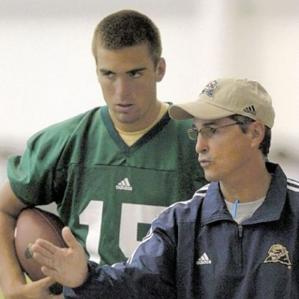 Pitt head coach Walt Harris talks with quarterback Joe Flacco during practice.