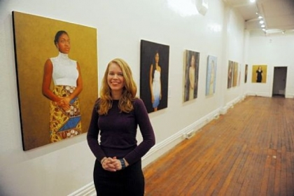 Artist Sonja Sweterlitsch with her portrait of singer-songwriter Joy Ike and the exhibit &quot;Beautiful Dreamers&quot; at Fe Gallery, Lawrenceville.