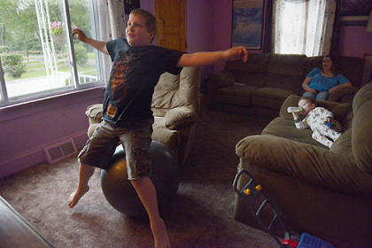Joseph Gallucci, 10, lets out his energy by bouncing on a large rubber ball, something he does often. The bouncing is part of his self-stimulation routine, activity common in persons with autism.