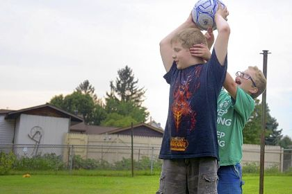 Joseph Gallucci, 10, and brother John, 8, play soccer at their home in Burgettstown. Joseph is low-functioning autistic while John has Asperger's syndrome, described as a form of high-functioning autism.