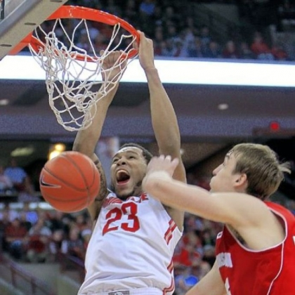 Ohio State's Amir Williams, left, dunks over Wisconsin's Sam Dekker in the second half of the Buckeyes' 58-49 Big Ten victory Tuesday night in Columbus, Ohio.