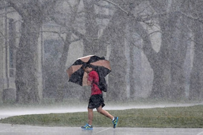 A student crossing The Cut at Carnegie Mellon University got caught in this morning's rain.