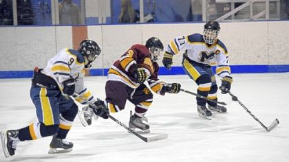 Roman Kraemer (3) of Serra Catholic controls the puck against Mars&#039; Ed Schwadron, left, and Reed Salada in the Planets&#039; 2-1 victory Nov. 21. After starting the year 1-3, Serra Catholic won its next five games.