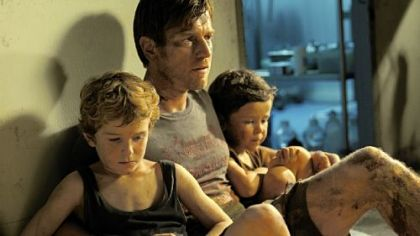 "Ewan McGregor stars as the father to Samuel Joslin, left, and Oaklee Pendergast in ""The Impossible."""