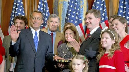 House Speaker John Boehner, R-Ohio, left, performs a mock swearing in for Rep. Keith Rothfus, R-Pa., and his family Thursday on Capitol Hill in Washington as the 113th Congress convened.