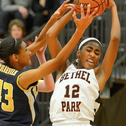 Bethel Park's Mariah Penascino, right, battles for rebound with Mt. Lebanon's Gabriella Caminos Thursday at Bethel Park. Bethel Park won, 60-54.