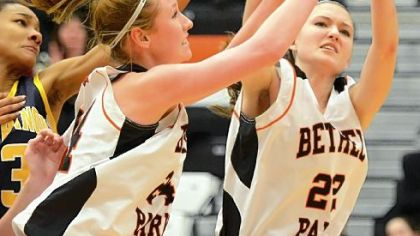Bethel Parks Samantha Simpson, right, and Paige Kochka-Puskar try to corral a loose ball Thursday against Mt. Lebanon.