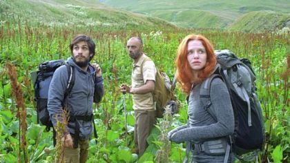 "Gael Garcia Bernal and Hani Furstenberg are led through treacherous terrain by mysterious mountaineer Bidzina Gujabidze, center, in ""The Loneliest Planet."""