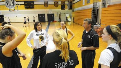 Husband-and-wife basketball coaches Debby and Dave Wilson run the South Side Beaver girls practice Dec. 31. The Wilsons are believed to be the first husband and wife coaching duo in WPIAL history.