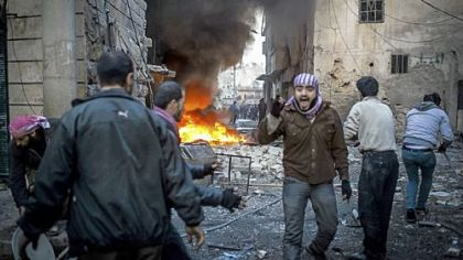 A man shouts after a missile hits a house in Aleppo, Syria, on Thursday.