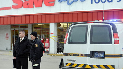 Pennsylvania State Police outside a Save-A-Lot store at Crossroads Plaza in East Huntingdon where a trooper shot and killed a man authorities said stabbed the trooper.