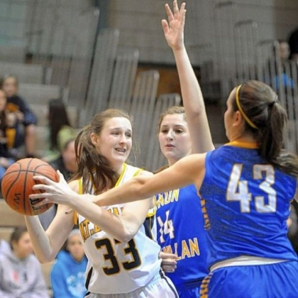 Mt. Lebanon's Christine Ehland tries to pass around Canon-McMillan's Danielle Parker and Olivia Lorusso.