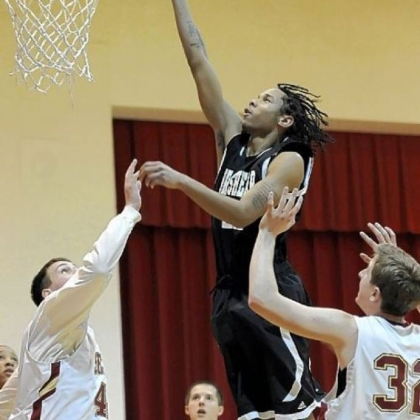 Brashear's Tyler Smith takes it to the rim during a non-league victory against Serra Catholic.