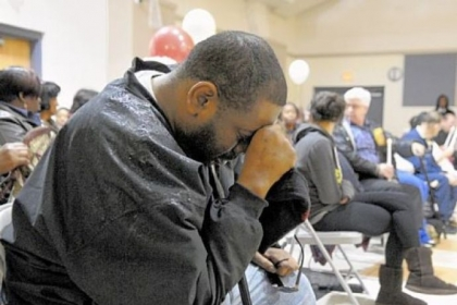 Daniel Cutrary of Sheraden mourns his uncle, Isaiah Dent, along with 200 people at the Hays Manor housing development community center in McKees Rocks. Mr. Dent, 61, a community activist and clothing designer, was found beaten to death in his apartment.