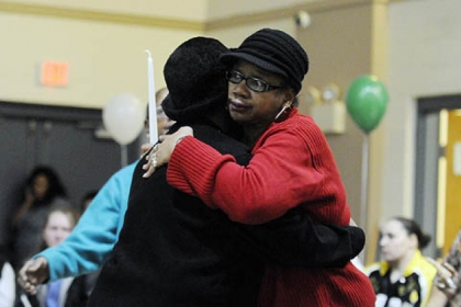 Lachoa Austin, left, of McKees Rocks comforts Carrol Dent of Youngstown, Ohio, the sister of Isaiah Dent, 61, during a memorial service.