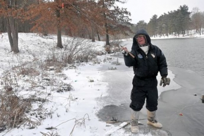 Jerry Roman stands at the edge of snow- and iced-covered North Park Lake to cast his line into the unfrozen portion of the lake last week.