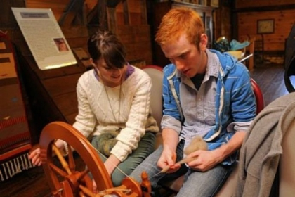 Natalie Woodruft, a junior at Saint Vincent College, and Zach Noble, a senior, split the spinning duties while learning to spin.