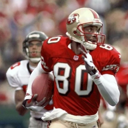 Jerry Rice runs for a touchdown in 1998.