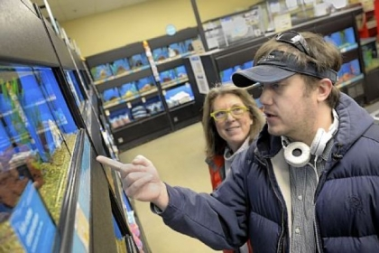Jonah Fite, who has an aquarium at his South Side house, shops at the Waterfront for new fish. His mother, Cindy McHolme, accompanies him, as she sometimes does on trips to stores, doctors' offices and supermarkets.