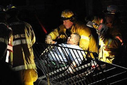 Pittsburgh rescue workers free Annette Wade, 52, from a collapsed stairway Thursday at the Allegheny Commons East complex on the North Side.