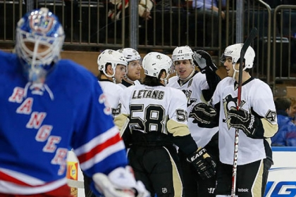 Rangers goaltender Henrik Lundqvist skates away as Evgeni Malkin and the Penguins celebrate Malkin's goal in the first period Thursday at Madison Square Garden in New York.