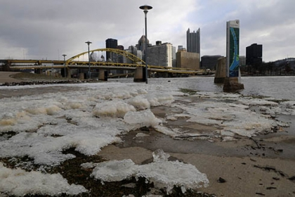 Chunks of ice lay along the North Shore as the waters of the Allegheny River receded today.