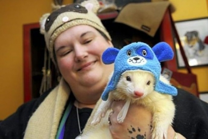 Shannon Moore of Oakland holds her ferret, Mr. Vanilla Bean, during the Winter Wonderland party.
