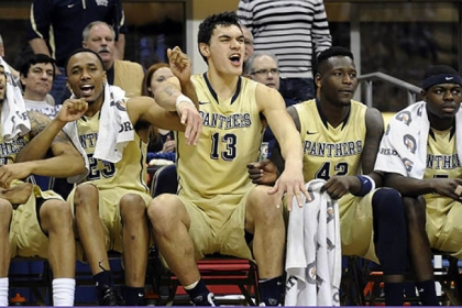 Pitt's Steven Adams celebrates with teammates as Tray Woodall makes a late-game free throw against Syracuse late in the second half at the Petersen Events Center this afternoon.