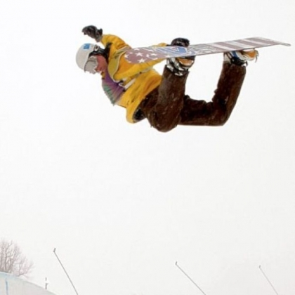 Snowboarder Dan Genditzki of Bedford, Pa., practices in the halfpipe at Seven Springs Mountain Resort Friday in preparation for the U.S. Open Snowboarding Championships qualifiers this weekend. Genditzki is doing a method grab, a fundamental snowboarding trick where the rider grabs the board behind his back with his lead hand.