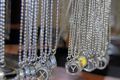 The typewriter necklaces made by Jeanne Cherry, 56, of Plum will be among items for sale at the I Made It! market from noon to 5 p.m. today at the former Joseph-Beth Booksellers store in the SouthSide Works.