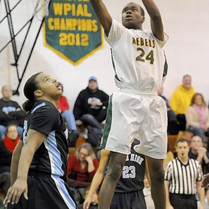 Seton-LaSalle's Levi Masua scored 15 points against Washington in the Rebels' 63-50 victory.