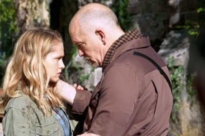 "John Malkovich, right, plays a zombie hunter and Teresa Palmer is his daughter, who starts to fall for a zombie, in ""Warm Bodies."""