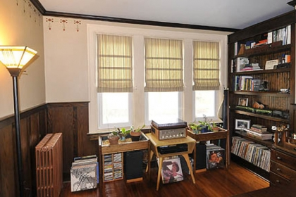 On the second floor, Chris Clarke built bookcases and installed dark wainscoting to create an office.