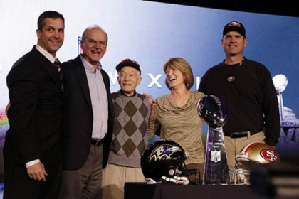 San Francisco 49ers head coach Jim Harbaugh, right, and Baltimore Ravens head coach John Harbaugh, left, pose with their parents, Jack and Jackie, and grandfather Joe Cipiti during a news conference.