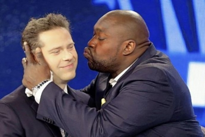A jubilant Warren Sapp, right, kisses Chris Rose, who served as host of the Pro Football Hall of Fame announcement show Saturday for NFL Network.