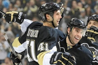Robert Bortuzzo, left, is mobbed by teammates after scoring his first NHL goal in the Penguins&#039; 5-1 rout of New Jersey Saturday at Consol Energy Center.