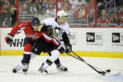 Washington Capitals right wing Joey Crabb battles for the puck against Penguins defenseman Simon Despres during the first period.