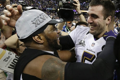 Baltimore Ravens linebacker Ray Lewis, left, and quarterback Joe Flacco celebrate their 34-31 win against the San Francisco 49ers in Super Bowl XLVII.