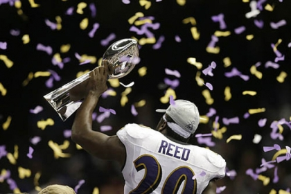 Ravens safety Ed Reed holds the Vince Lombardi Trophy after defeating the 49ers, 34-31, in the Super Bowl Sunday in New Orleans.
