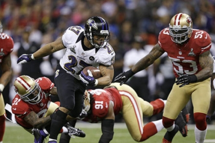 Ravens running back Ray Rice escapes from the 49ers Donte Whitner, Ray McDonald and NaVorro Bowman during the first half of Super Bowl XLVII.