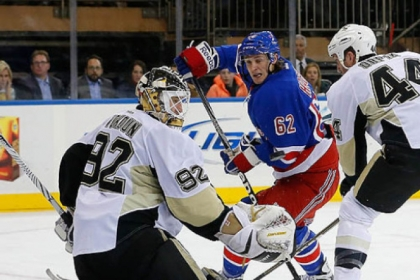 Brooks Orpik helps goalie Tomas Vokoun defend a shot by the Rangers&#039; Carl Hagelin in a Jan. 31 game.
