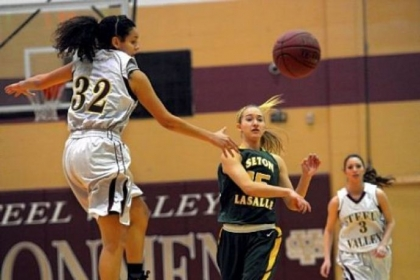 Seton-LaSalle's Julie DeKlaven passes in front of Steel Valley's Cece Dixon.