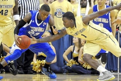 Pitt's Tray Woodall reaches in for the ball against Seton Hall's Fuquan Edwin in the first half at the Petersen Events Center Monday night.